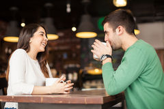 Happy couple at a coffee shop Stock Photography