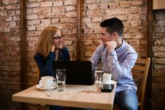 Happy couple in a coffee shop royalty free stock image