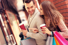 Happy couple with coffee shopping in the mall stock images