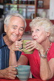 Happy Couple in Coffeehouse Royalty Free Stock Photos