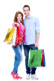 Happy couple with colored shopping bags. Stock Photos