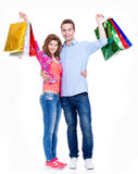 Happy couple with colored shopping bags. Royalty Free Stock Photography