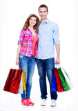 Happy couple with colored shopping bags. Stock Images