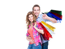 Happy couple with colored shopping bags. Royalty Free Stock Image