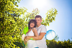 Happy couple with colorful balloons outdoors Royalty Free Stock Photo