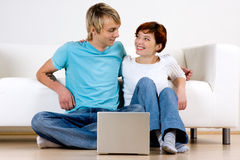 Happy couple with computer stock photos