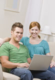 Happy Couple on Computer Stock Images
