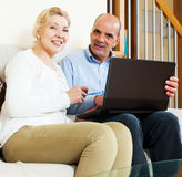 Happy couple with computer Royalty Free Stock Photo
