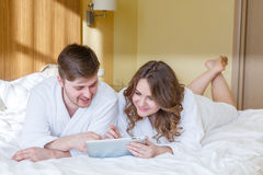 Happy couple with computer tablet. Royalty Free Stock Image