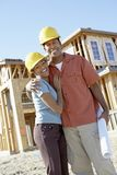 Happy Couple At Construction Site Royalty Free Stock Photography