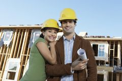 Happy Couple At Construction Site Royalty Free Stock Images