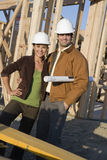 Happy Couple At Construction Site Royalty Free Stock Image