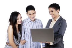 Happy couple with consultant. Happy couple and a consultant discussing together Stock Photos