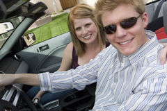 Happy Couple In Convertible Car Royalty Free Stock Images