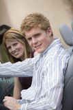 Happy Couple In Convertible Car Royalty Free Stock Image