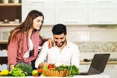 Happy Couple Cook with Laptop royalty free stock photos