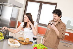 Happy couple cook together in modern kitchen Stock Images