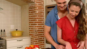 Happy couple with cookery book. In the kitchen stock video footage