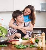 Happy couple cooking Royalty Free Stock Images