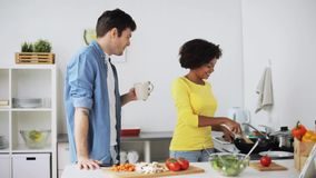 Happy couple cooking food at home kitchen stock footage