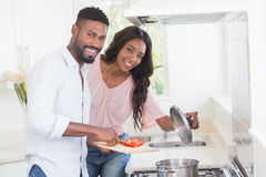 Happy couple cooking food together Royalty Free Stock Photography