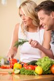 Happy couple cooking food together. Stock Image