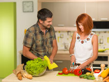 Happy couple cooking Royalty Free Stock Photography