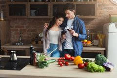 Happy couple cooking healthy food together royalty free stock image