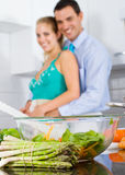 Happy couple cooking in kitchen Royalty Free Stock Image