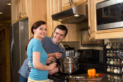 Happy Couple Cooking in the Kitchen - Horizontal royalty free stock photos