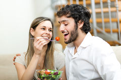 Healthy eating. Happy couple cooking a meal together Royalty Free Stock Image