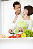 Happy Couple Cooking Together Royalty Free Stock Image