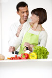 Happy Couple Cooking Together Stock Image