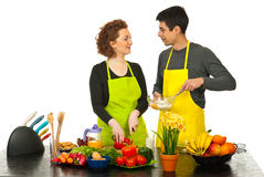 Happy couple cooking together Royalty Free Stock Images