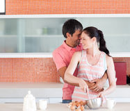 Happy couple cooking together Royalty Free Stock Photo