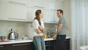 Happy couple cooking together at home. Man and woman having fun at kitchen. stock footage