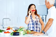 Mature couple cooking at home. Happy couple cooking together at home royalty free stock image