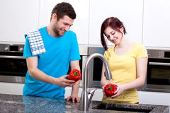 Happy couple cooking together Royalty Free Stock Photos