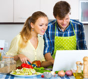 Happy couple cooking vegetables Royalty Free Stock Photo