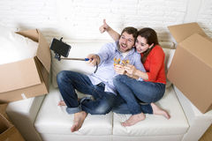 Happy couple on couch having fun together celebrating champagne Stock Images