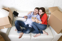 Happy couple on couch having fun together celebrating champagne Stock Image