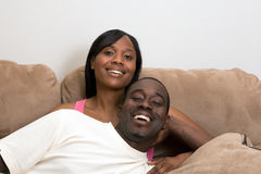Happy Couple on a Couch-Horizontal Royalty Free Stock Images