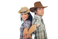 Happy couple in cowboy's hats Royalty Free Stock Photo