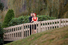 Happy Couple Cuddling on Bridge Royalty Free Stock Images