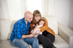 Happy couple cuddling their newborn baby boy Stock Photography