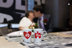 The happy couple and cups Stock Image