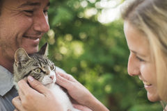 Happy couple with cute kitten Stock Photos
