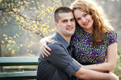Happy couple - cute lovers in park Stock Images