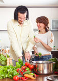 Happy couple cutting the celery for salad in home kitchen Stock Photo