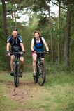 Happy couple cycling in nature Royalty Free Stock Images